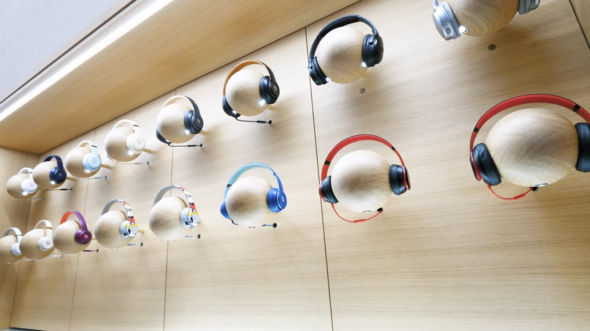 apple sign : Paris, France - Circa 2019: Beats Apple products headphones ond mannequin heads are displayed inside the new Apple Store Champs-Elysees largest French store located in the heart of the capital