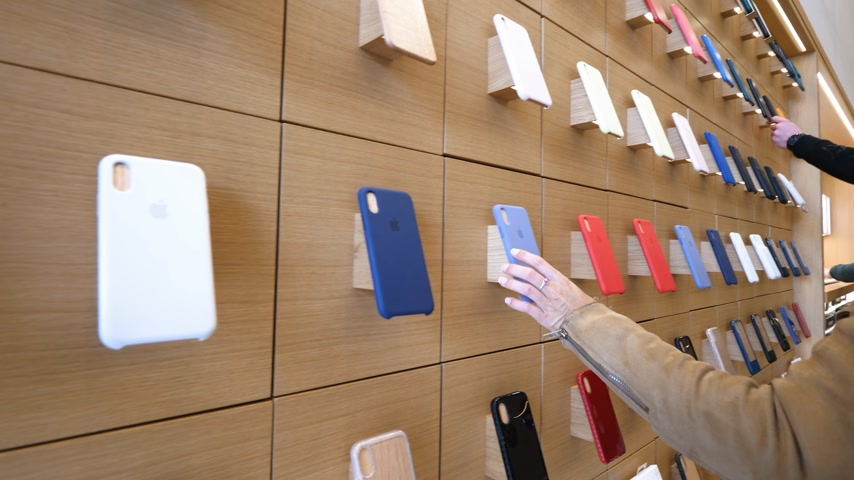 champs elysee : Paris, France - Circa 2019: Apple iPhone XS protection cases products are displayed inside the new Apple Store Champs-Elysees largest French store located in the heart of the capital people testing