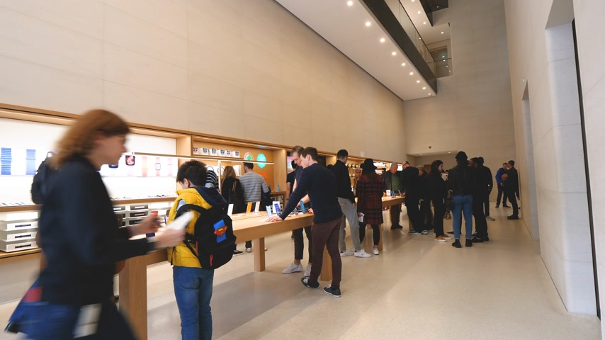 champs elysee : Paris, France - Circa 2019: People texting Apple products displayed inside the new Apple Store Champs-Elysees largest French store located in the heart of the capital - French flagship store building