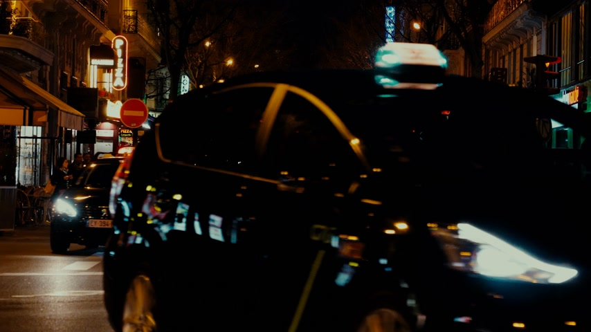 homeopático : Paris, France - Circa 2019: Cinematic color over typical French street in Paris with cars taxi commuters pedestrians at night commuting going home, restaurants sightseeing 4k UHD