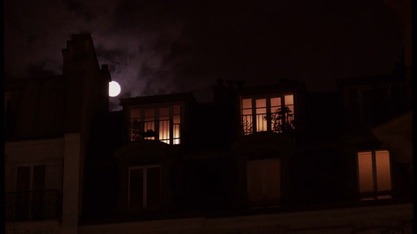 grotesque : VHS vintage tape film over beautiful full moon over Parisian Hausmannian mansard roof balconies on Champs-Elysees at night 4K UHD footage for film and series Stock Footage