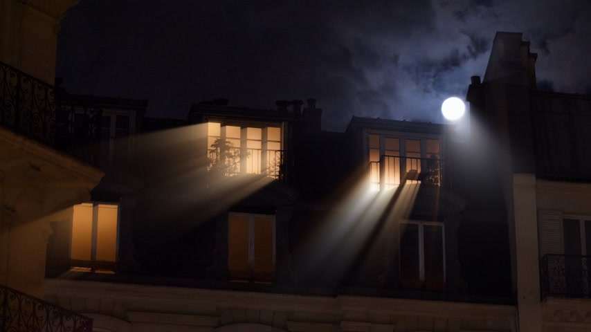 grotesque : Radiating light beams coming from large mansard roof windows and beautiful full moon over Parisian Hausmannian building on Champs-Elysees at night with male silhouette walking inside