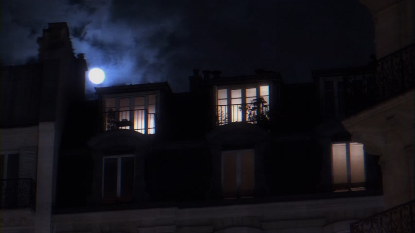 champs elysee : Beautiful full moon over Parisian Hausmannian building on Champs-Elysees at night with male silhouette walking inside apartment windows 4K UHD footage digital glitch bad transmission effect