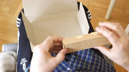 積み重ねられた : Paris, France - Mar 29, 2019: Senior man looking at the packaging before unboxing latest Withings move activity tracking watch with Unsurpassed battery life and Infinite possibilities for customize bl