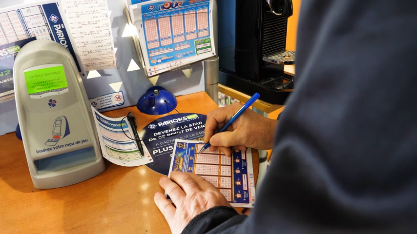 impatience : Paris, France - 29 Mar 2019: Newsworthy sunlight flare over senior male hands marking numbers on EuroMillions ticket inside Tabaco press kiosk hoping to win the big jackpot of 10000000 millions euros