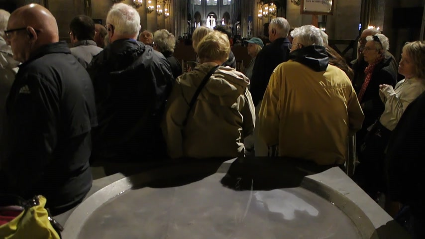 chapel : Paris, France - Circa 2017: Crowd of tourists admiring the altar of Notre-Dame De Paris cathedral - rear view perspective shot with wide angle lens