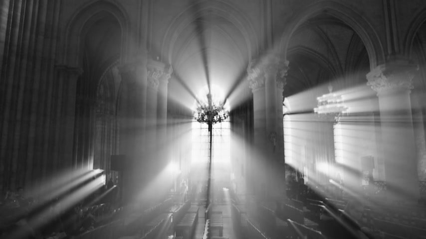 chrześcijaństwo : Paris, France - Circa 2017: Majestic holly light beams through windows columns and stained glass windows with rooftop and magnificent chandelier of Notre-Dame de Paris cathedral with visitors tourists people  black and white