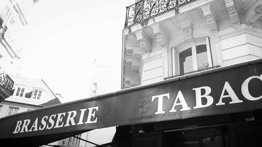 бульвар : Cinematic panning over Brasserie Tabac Tobacco Bar brewery signage on the pergola of a restaurant in central Paris on the first floor of an Haussmannian building