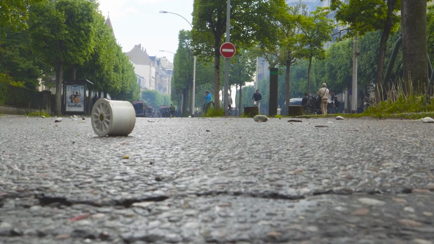 gösterici : Strasbourg, France - Apr 28, 2019: Smoke grenade tear gas ammo waste low angle view of people and police on Allee de la Robertsau after police altercation with Yellow Vests demonstrators near Council of Europe Stok Video