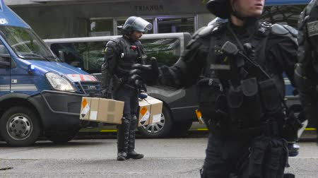 teargas : Strasbourg, France - Apr 28, 2019: French Police officers gendarmes loading in van boxes with 1330-14-548-9477 hand launcher grenades supply for next altercations Yellow vests protestors