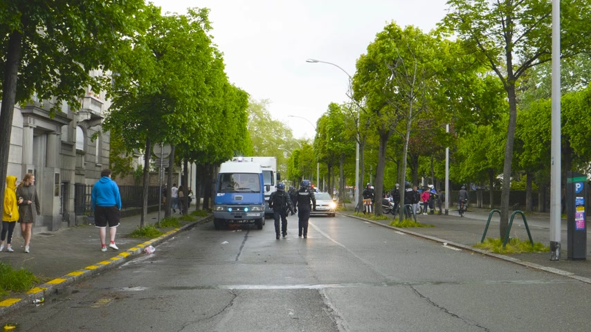 champs elysee : Strasbourg, France - Apr 28, 2019: French Police officer securing street Alee de la Robertsau near Council of Europe street after altercations with Yellow Vests