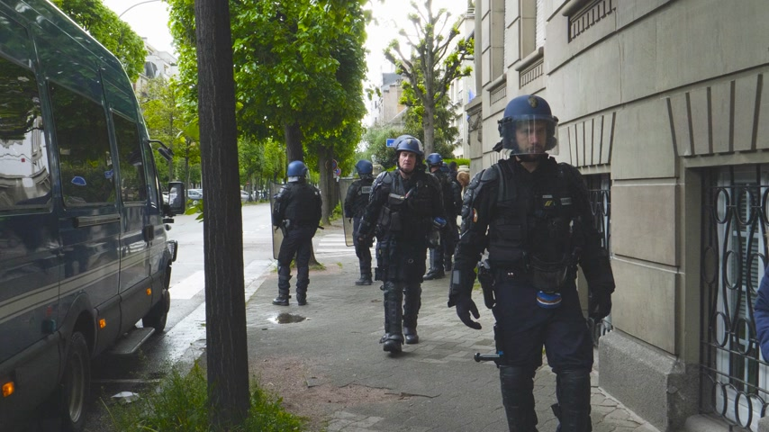 bala : Strasbourg, France - Apr 28, 2019: French Police officer securing zone during Yellow Vest on Rue Rene Schickele street after altercations Stock Footage