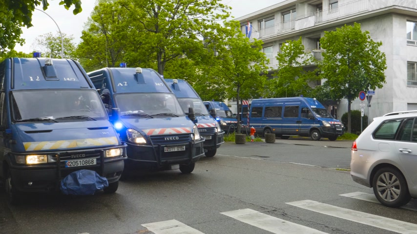 champs elysee : Strasbourg, France - Apr 28, 2019: Squadron of police gendarmerie vans securing entrance to Council of Europe over Allee de la Robertsau after altercations with Yellow Vests Gilets jaunes
