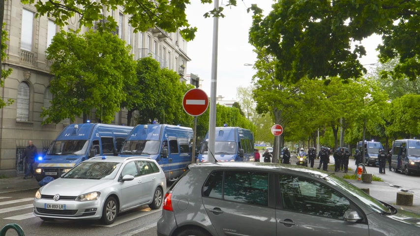 gösterici : Strasbourg, France - Apr 28, 2019: Squadron of police gendarmerie vans securing entrance to Council of Europe over Allee de la Robertsau after altercations with Yellow Vests Gilets jaunes