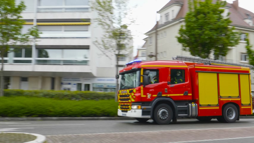 siren : Strasbourg, France - Apr 28, 2019: French Scania Firefighter with blue beacon lights turned on driving fast on the street for intervention
