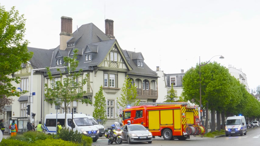 consulate : Strasbourg, France - Apr 28, 2019: Police officers and firefighter truck securing entrance to Rue Schweighaeuser after altercations with Yellow Vests Gilets jaunes slow motion