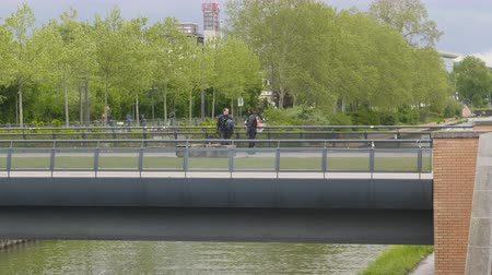gösterici : Strasbourg, France - Apr 28, 2019: Two CRS police officers surveilling the bridge near European Parliament Stok Video