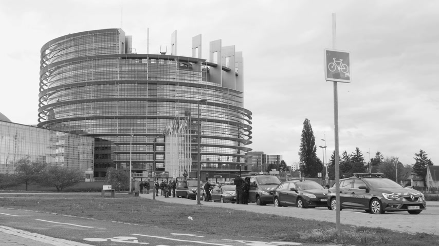 rali : Strasbourg, France - Apr 28, 2019: Establishing shot of European Parliament headquarter being secured by police gendarmerie officers at entrance during Yellow Vests movement on Saturday black and white,