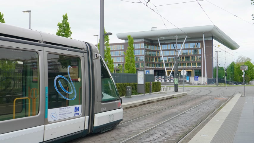 european court of human rights : Strasbourg, France - Circa 2019: Electric tramway in front of AGORA council of Europe building in Strasbourg on a calm spring day