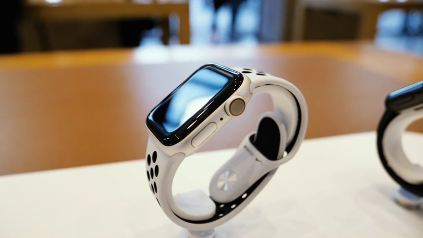 wristband : Paris, France - Circa 2018: luxury new Apple Watch Nike Series 4 smartwatch wearable computer inside Apple Store with customers silhouettes in background Stock Footage