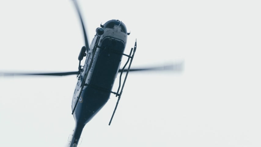 sheriff : Paris, France - Circa 2019: Handheld footage view from below at the surveilling Gendarmerie French police helicopter in the sky during French yellow Vests Gilets Jaunes protest Stock Footage