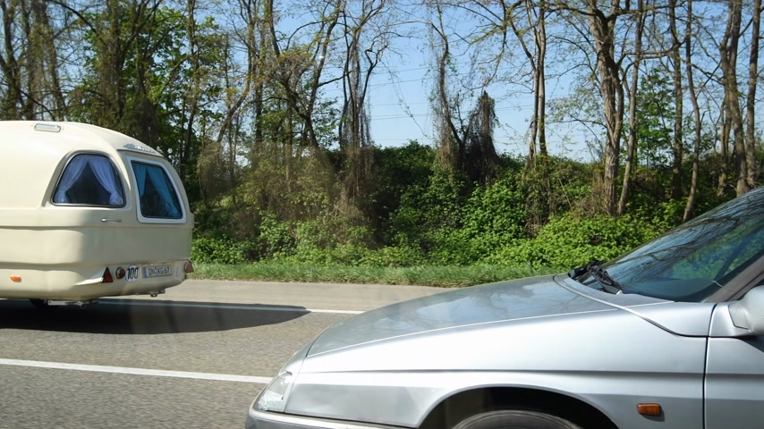 congested : Strasbourg, France - Apr 19, 2019: Congested traffic on French highway long autoroute with luxury fashionable convertible Mercedes-Benz with vintage retro RV trailer camp Stock Footage
