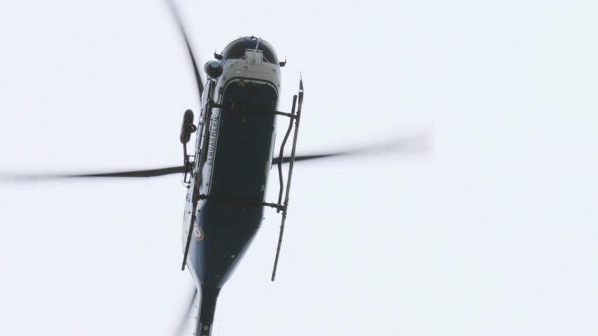 sheriff : Paris, France - Circa 2019: Cinematic view from below at the surveilling Gendarmerie French police helicopter during French yellow Vests Gilets Jaunes protest