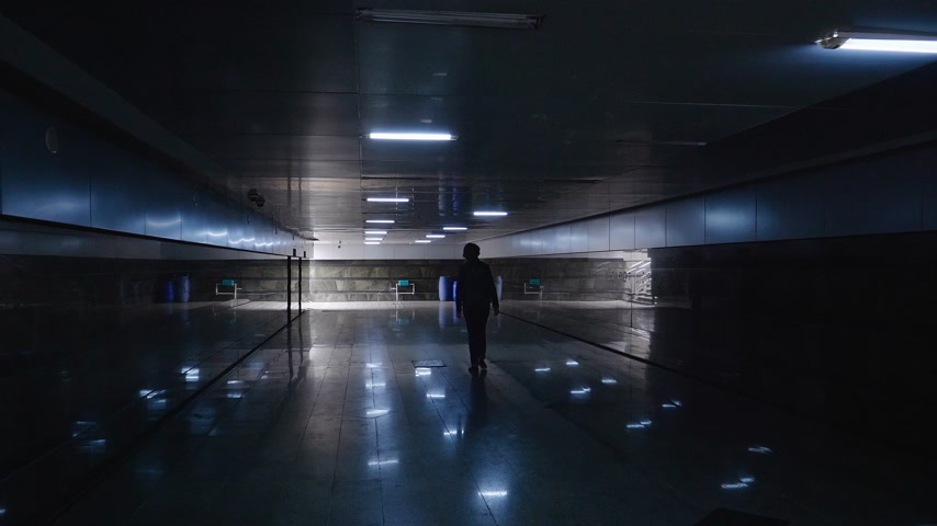 baku : Lonely young woman walking in the dark underground passage tunnel under busy street of Baku, Azerbaijan Stock Footage