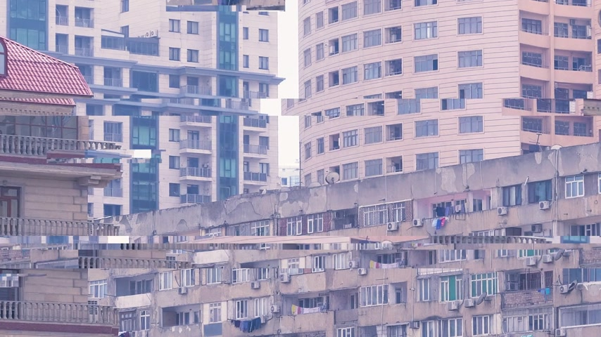 socialismo : Pan over soviet architecture and modern Azerbaijani apartment building - covered balconies and lots if air conditioning units on the balconies real estate investment in Baku digital glitch bad signal