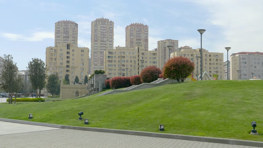 baku : Yasamal Parki green oasis in central Baku surrounded with tall apartment real estate buildings