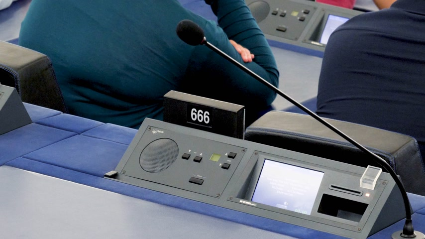 helyettes : Strasbourg, France - Circa 2018: Modern Simultaneous Interpreting translation digital equipment dashboard with microphone and empty triple six 666 number of European Parliament seat