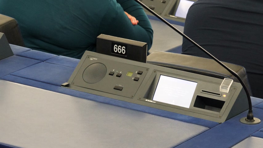 посетитель : Strasbourg, France - Circa 2018: Modern Simultaneous Interpreting translation digital equipment dashboard with microphone and empty triple six 666 number of European Parliament seat