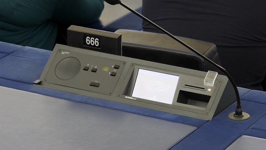 oturum : Strasbourg, France - Circa 2018: Zoom out from Modern Simultaneous Interpreting translation digital equipment dashboard with microphone and empty triple six 666 number of European Parliament seat