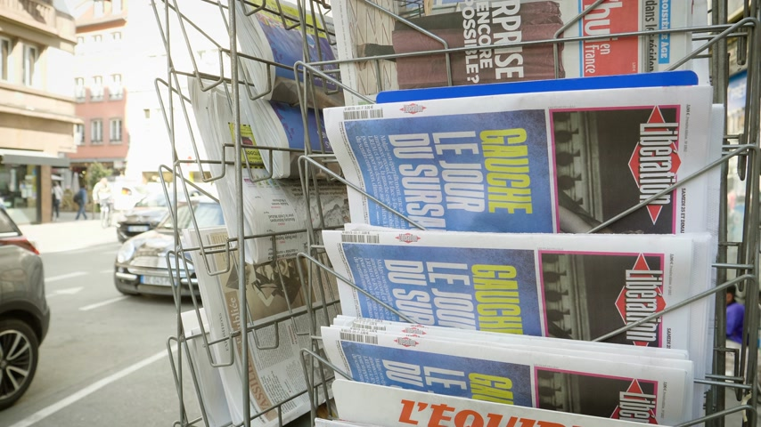 buy newspaper : Strasbourg, France - May 25, 2019: French press kiosk Liberation newspaper featuring 2019 European Parliament election predictions a day before the vote