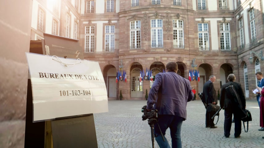 french media : Strasbourg, France - May 27, 2019: Media journalists walking to French polling station Bureau de vote sign on door 26 May, Sunday of 2019 European Parliament election - courtyard of Hotel de Ville City hall