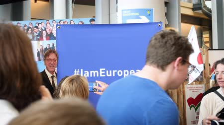 helyettes : Strasbourg, France - Circa 2018: I am European and I am proud people taking photos at stand with message and next to Guy Verhofstadt real size print