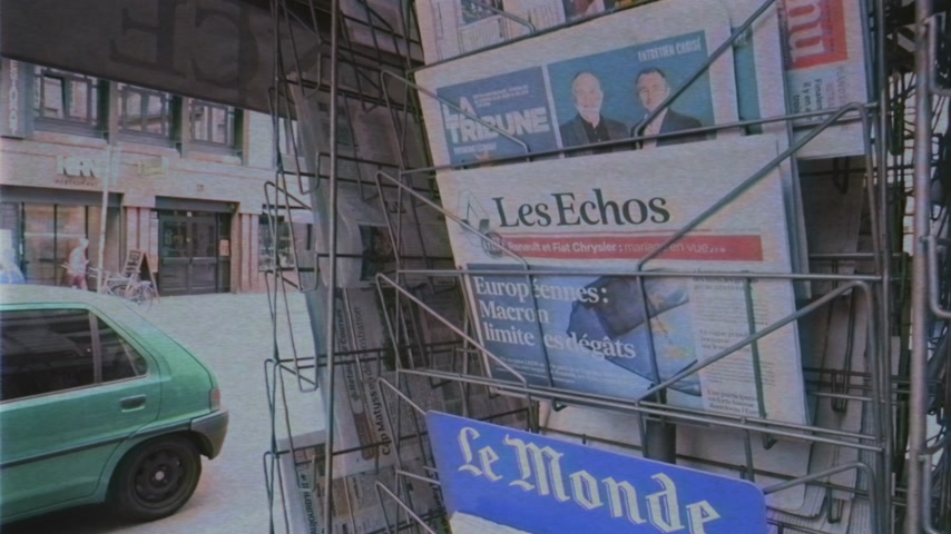 holding newspaper : Strasbourg, France - May 27, 2019: VHS vintage tape film of city scene with newspaper stand featuring breaking news Les Echos newspaper front page with tile Macron limits the damage -  street press kiosk newsstand with the results of 2019 European Parliam