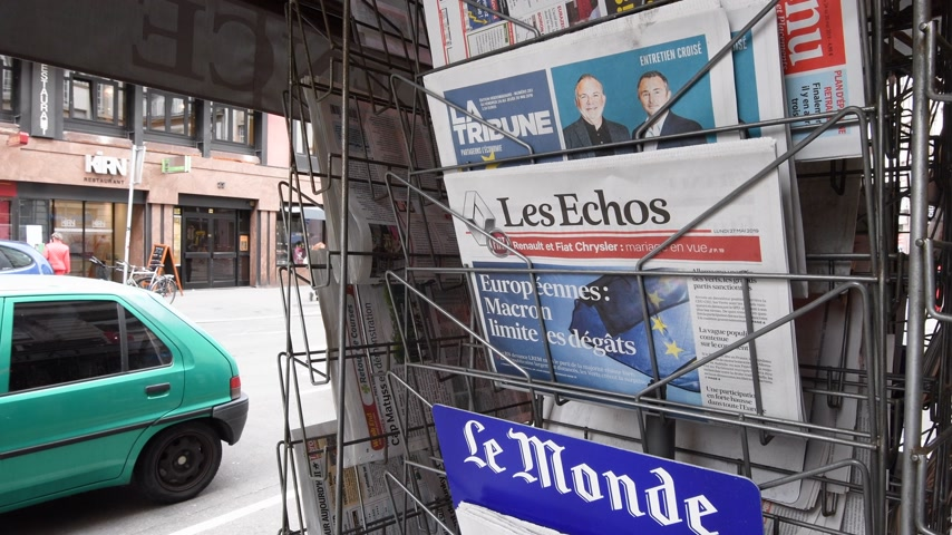 front cover : Strasbourg, France - May 27, 2019: City scene with newspaper stand featuring breaking news Les Echos newspaper front page with tile Macron limits the damage -  street press kiosk newsstand with the results of 2019 European Parliament election