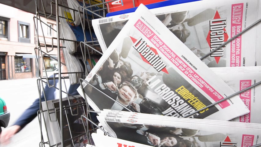 holding newspaper : Strasbourg, France - May 27, 2019: Press kiosk stand with Liberation newspaper front page newsstand with the results of 2019 European Parliament election for Yannick Jadot Green Party