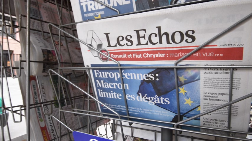 holding newspaper : Strasbourg, France - May 27, 2019: City scene with newspaper stand featuring breaking news Les Echos newspaper front page with tile Macron limits the damage -  street press kiosk newsstand with the results of 2019 European Parliament election