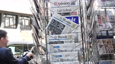 latest : Strasbourg, France - May 25, 2019: Multiple Le Monde press kiosk newspaper featuring Theresa May and title  Spectre of a hard Brexit - slow motion Stock Footage