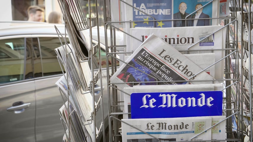 holding newspaper : Strasbourg, France - May 27, 2019: French Le Monde front page on street press kiosk newsstand with title Europe dealing with populism before 2019 European Parliament election