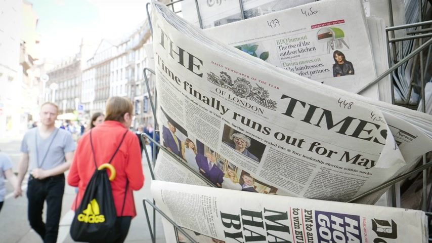 latest : Strasbourg, France - May 24, 2019: Time finally runs out for Theresa May title on The Times newspaper with pedestrians people walking on French street - Brexit news