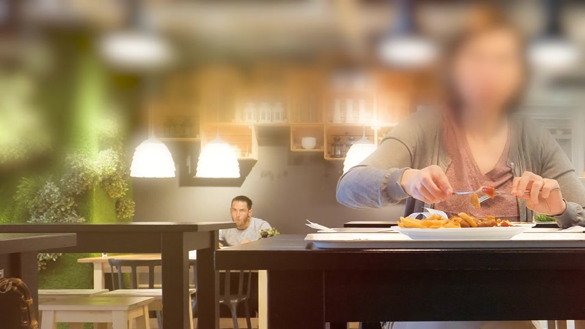 pan fried : Paris, France - Circa 2019: Pan from left to right over unrecognizable woman inside IKEA food restaurant eating French fries and Swedish meatballs drinking Pepsi sweet drink Stock Footage