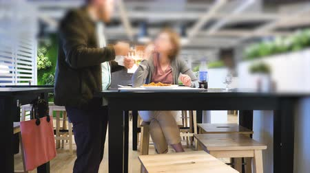 makbuz : Paris, France - Circa 2019: Man and woman eating at the IKEA food restaurant having fun eating French fries and drinking Pepsi - man checking receipt