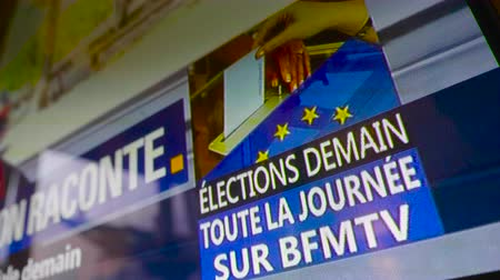 demain : Strasbourg, France - Circa 2019: Low angle view of TV screen detail featuring generic banner with text Elections Tomorrow see them on BFM TV channel