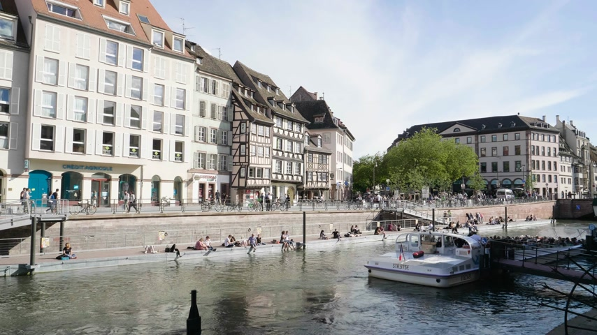 picturesque quarters : Strasbourg, France - Circa 2019: VHS vintage tape film over Strasbourg famous promenade pedestrian street Quai des Bateliers with Batorama river port