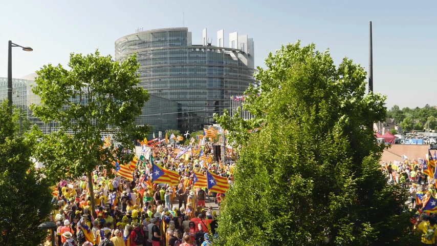 istek : Strasbourg, France - Jul 2 2019: Aerial view over thousands of people demonstrating at protest front of EU European Parliament against exclusion of three Catalan elected MEPs - drone view Stok Video