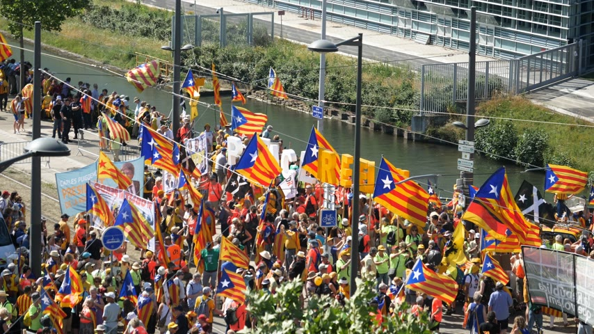 bizottság : Strasbourg, France - Jul 2 2019: Aerial drone view over thousands of people demonstrating with Catalan flags at protest front of EU European Parliament against exclusion of three Catalan elected MEPs slow motion