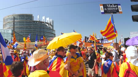 protestor : Strasbourg, France - Jul 2 2019: Group of people holding Estelada Catalan separatist flags demonstrate protest front of EU European Parliament against exclusion of three Catalan elected MEPs